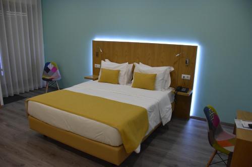 Uma cama ou camas num quarto em Hotel Império do Norte
