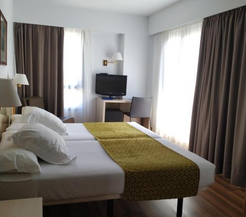 Ein Bett oder Betten in einem Zimmer der Unterkunft Hotel Ezeiza