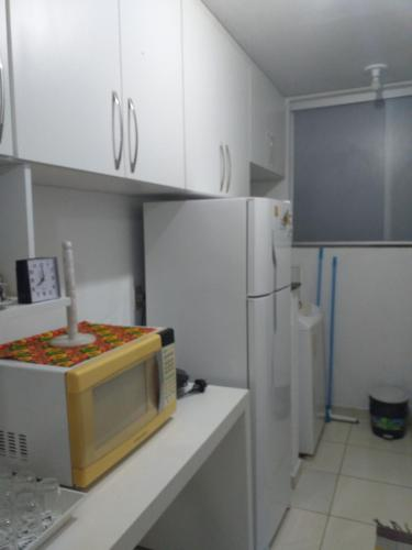 A kitchen or kitchenette at Apartamento Deluxe