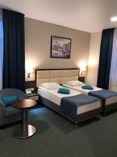 Кровать или кровати в номере Отель Искра