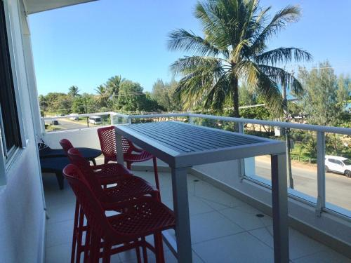 A balcony or terrace at Ulysses Beachfront Penthouse 13