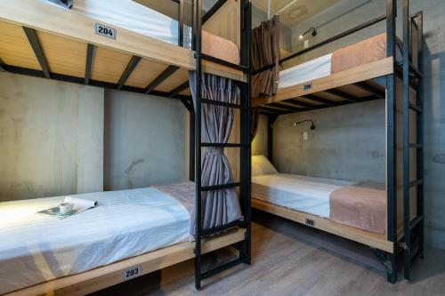 A bunk bed or bunk beds in a room at 9 Hostel and Bar