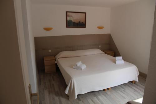 A bed or beds in a room at Résidence Domaine De Caranella