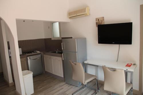 A kitchen or kitchenette at Résidence Domaine De Caranella