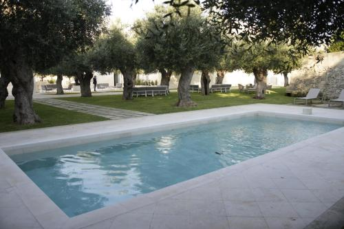 The swimming pool at or near La Fiermontina - luxury home hotel