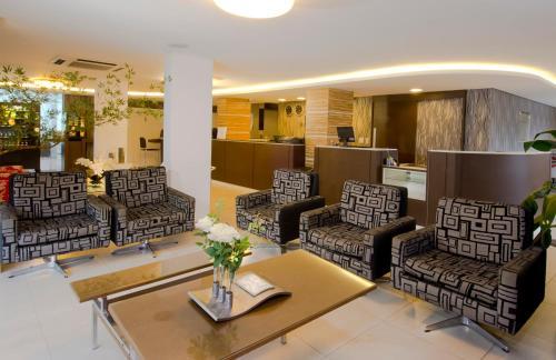 The lobby or reception area at Hotel Palmas Executivo