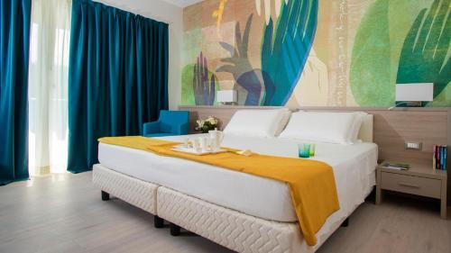 Postel nebo postele na pokoji v ubytování Hotel President