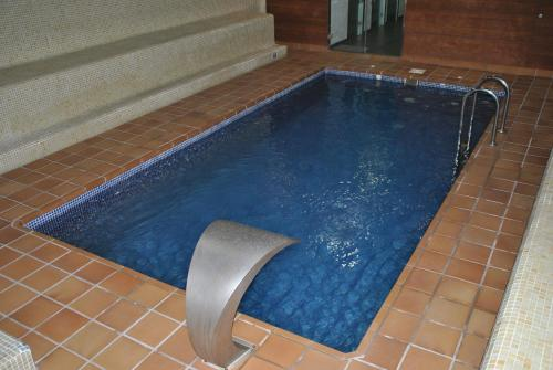 The swimming pool at or near Hotel Junquera