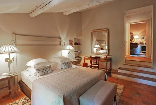 Un ou plusieurs lits dans un hébergement de l'établissement Baumanière - Les Baux de Provence