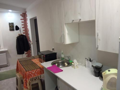 A kitchen or kitchenette at Guest House on Frunze