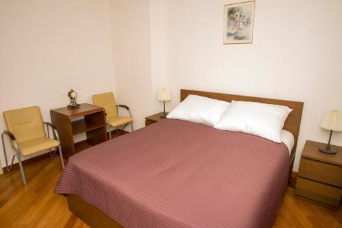Postel nebo postele na pokoji v ubytování Szucha Residence Apartment