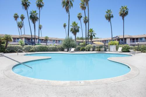 The swimming pool at or near Days Inn by Wyndham Fresno Central