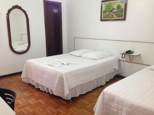 A bed or beds in a room at Hotel Miranelli