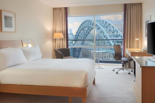 A bed or beds in a room at Hilton Newcastle Gateshead