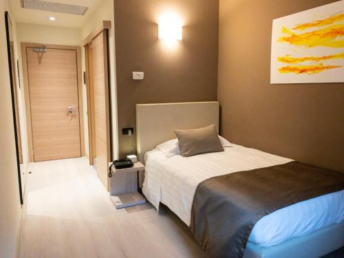 A bed or beds in a room at Helios Hotel & Restaurant