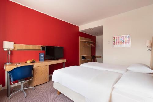 Ein Bett oder Betten in einem Zimmer der Unterkunft Park Inn by Radisson