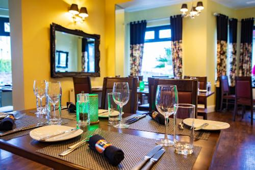 A restaurant or other place to eat at The Inn Boutique Hotel Bar and Restaurant
