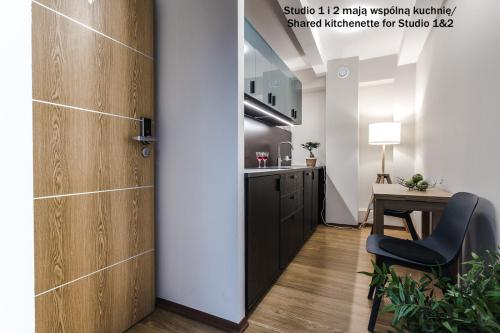 A kitchen or kitchenette at Apartamenty na Starówce / Old Town apartments