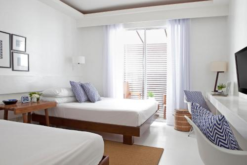 A bed or beds in a room at Blue Marina Boracay