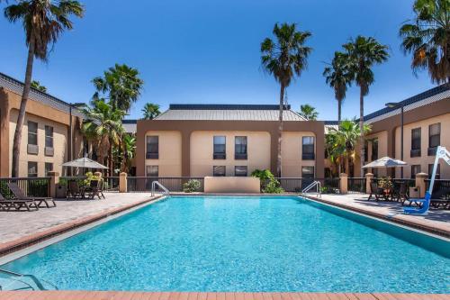 The swimming pool at or near Ramada by Wyndham Orlando Florida Mall