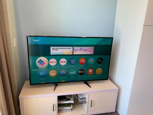 A television and/or entertainment center at Luxury Beachside Accomodation