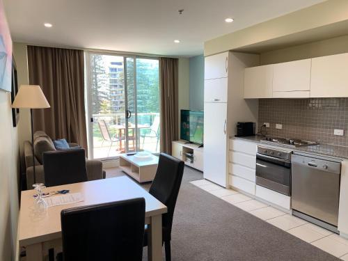 A kitchen or kitchenette at Luxury Beachside Accomodation