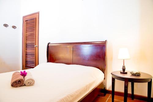 Cama ou camas em um quarto em Pelican Villa