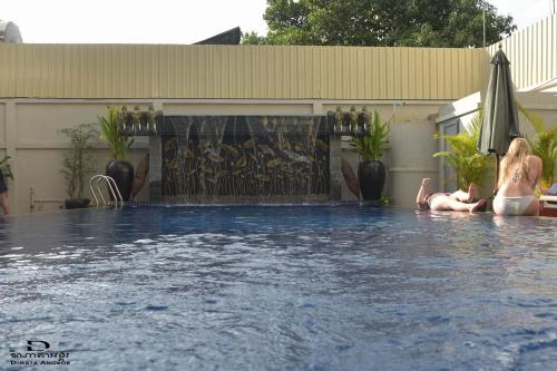 The swimming pool at or near Dinata Angkor Boutique Hotel