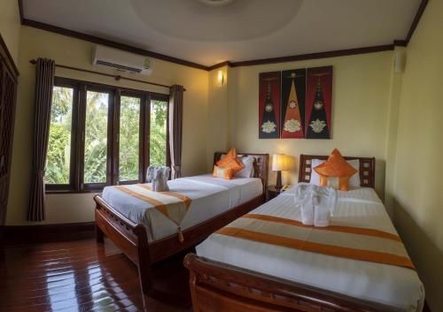 Ein Bett oder Betten in einem Zimmer der Unterkunft Ban's Diving Resort