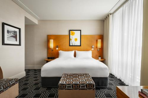A bed or beds in a room at Sofitel Montreal Golden Mile