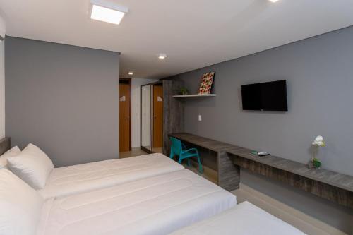 Cama ou camas em um quarto em Hotel Mais1