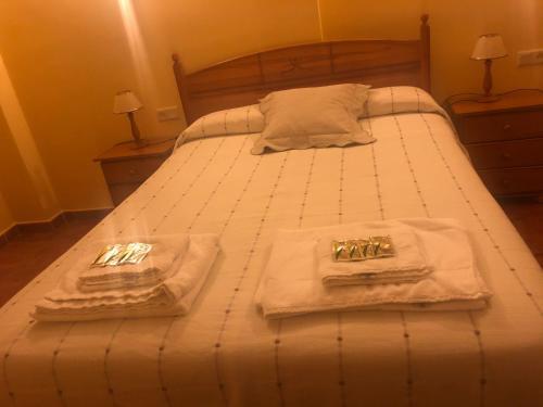 Cama o camas de una habitación en La Posada de Fray Leopoldo