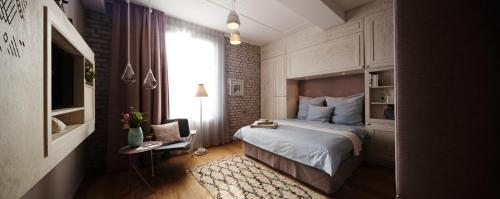 A bed or beds in a room at Libertine Lindenberg