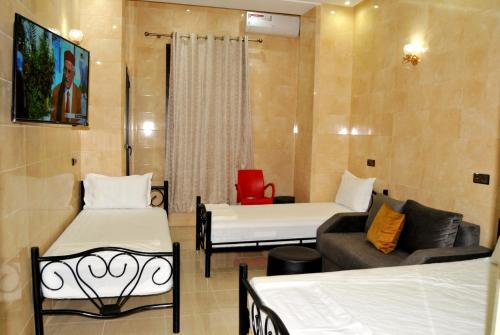 A bed or beds in a room at Jood