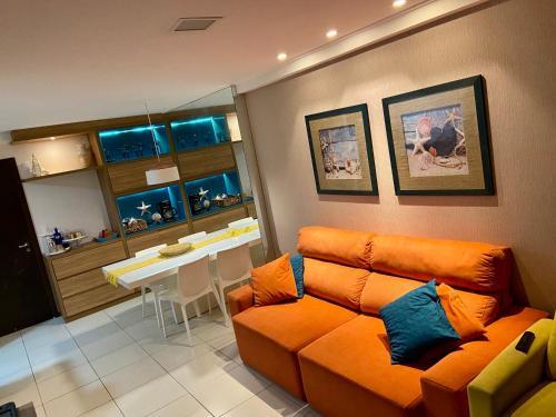 A seating area at Apartamento Barra Bali
