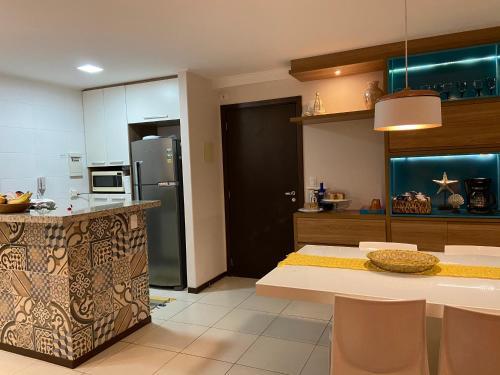 A kitchen or kitchenette at Apartamento Barra Bali