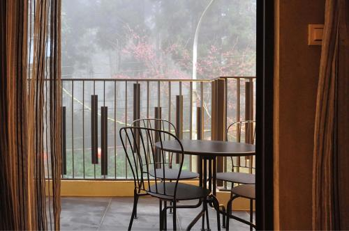 A balcony or terrace at Sheng Shine Forest Resort