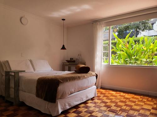 A bed or beds in a room at Hotel Casa Madero