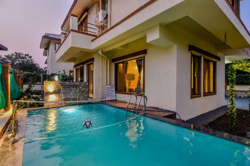 The swimming pool at or near EKO STAY- Tropicana Villa