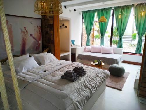 Łóżko lub łóżka w pokoju w obiekcie Oasi
