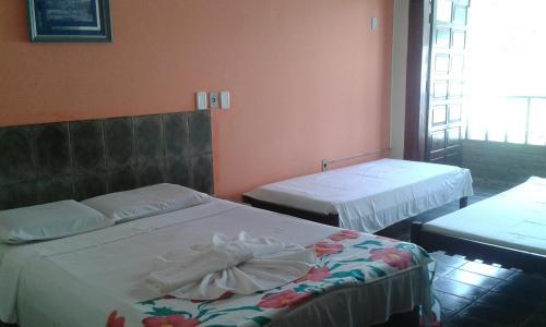 Кровать или кровати в номере Vale Verde Coroa Vermelha