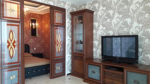 Телевизор и/или развлекательный центр в Идеал Апарт