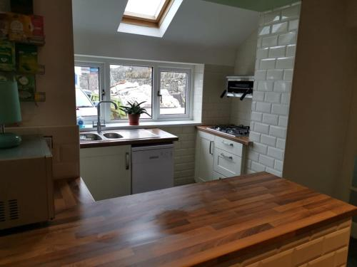 A kitchen or kitchenette at Mairs Bed and Breakfast.