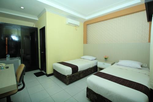 Tempat tidur dalam kamar di Allisa Resort Hotel