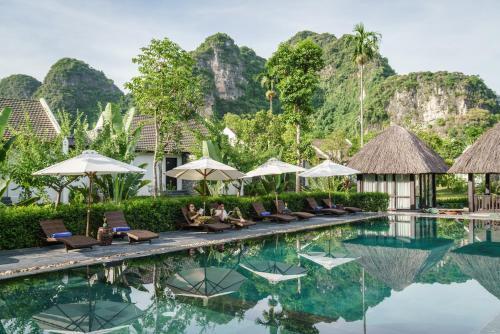 The swimming pool at or near Aravinda Resort Ninh Binh