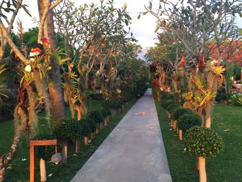 A garden outside Baan Thai Lanta Resort