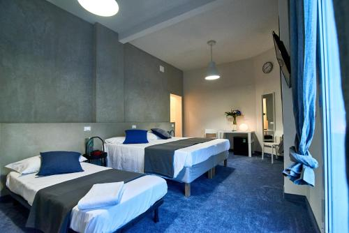 Letto o letti in una camera di Hotel Concordia