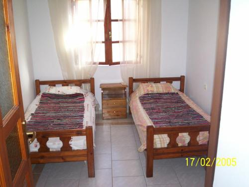 A bed or beds in a room at Old House