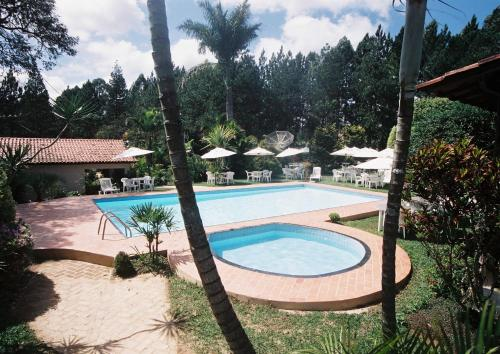 A view of the pool at Estalagem Fazenda Lazer or nearby