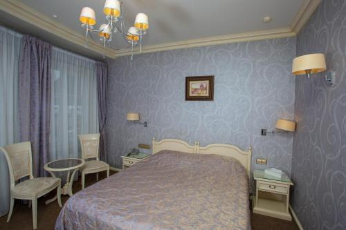 A bed or beds in a room at Dvoryanskoe Gnezdo